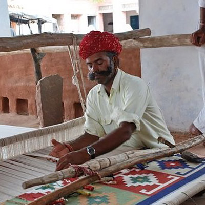 India Textiles Tour artisans hand weaving dhurrie rugs