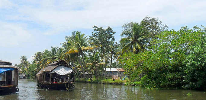 Houseboat cruise through the backwater canals in Kerala