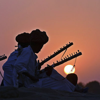 Musicians at sunset in the Rajasthan desert